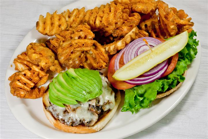 California Burger. Delicious 1/3 pound burger topped with sautéed mushrooms, avocado, and jack cheese. Served with your choice of house seasoned fries, fruit, potato salad, cup of soup, or salad.