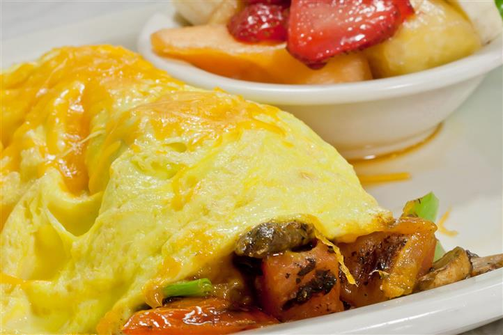 Linguisa Omelet. Diced linguisa, onions, olives, green chilies, topped with cheddar cheese.