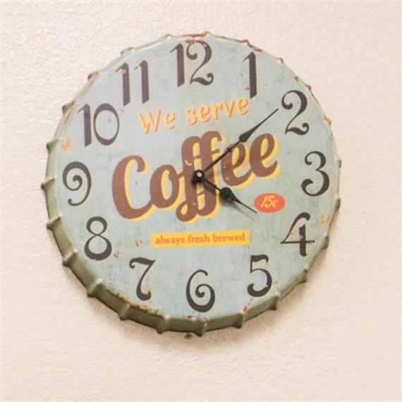 Quaint-looking clock on wall with wording - We serve coffee. Always fresh brewed.