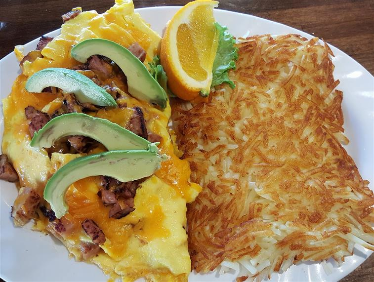California omelet. Avocado, bacon, tomatoes, topped with cheddar cheese.