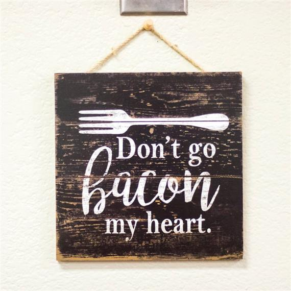 Wood hanging sign reading don't go bacon my heart.