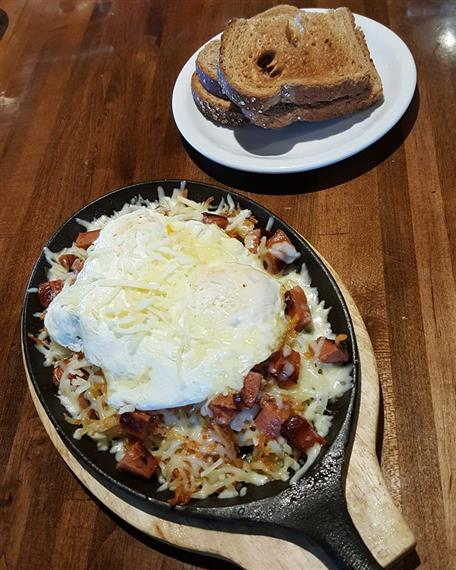 Portuguese Skillet. Bell peppers, onions, mushrooms, linguisa served on a bed of lightly seasoned home fries, three eggs any style and your choice of toast, hot cakes, or biscuit and gravy.