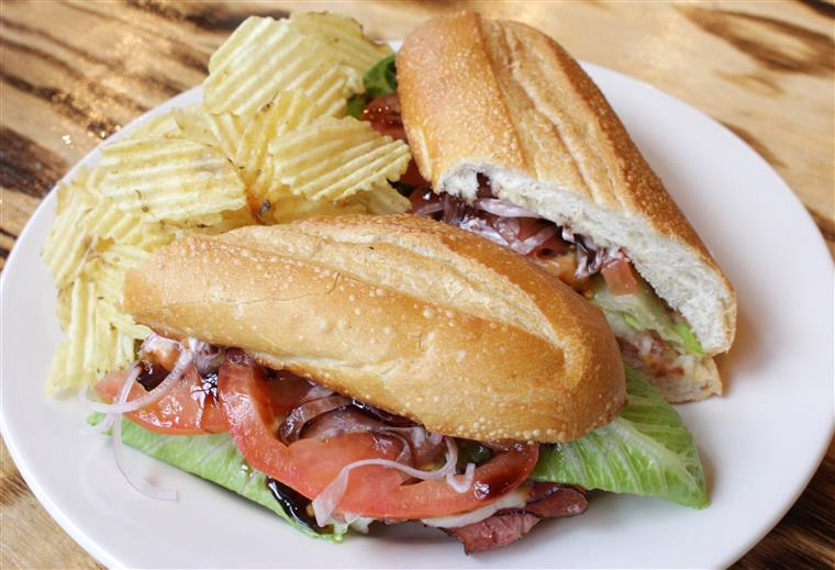 Turkey & Roast Beef Hoagie. Smoked turkey and roast beef, provolone cheese topped with bacon served on a toasted hoagie with mayo, green leaf lettuce and red onion with side of chips.