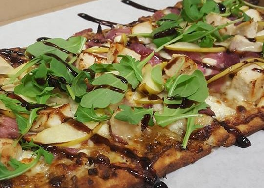 Giovanni Italian Flatbread. House made marinara, prosciutto (italian ham), ham, salami, fresh mozzarella, green onion, and finished with our balsamic glaze.