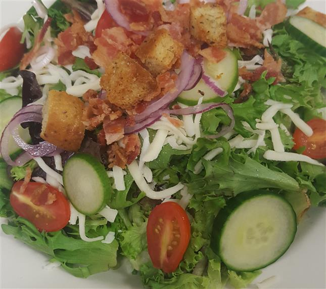 House salad with mixed greens, grape tomatoes, cucumbers, croutons, red onion, bacon, shredded cheddar jack cheese.