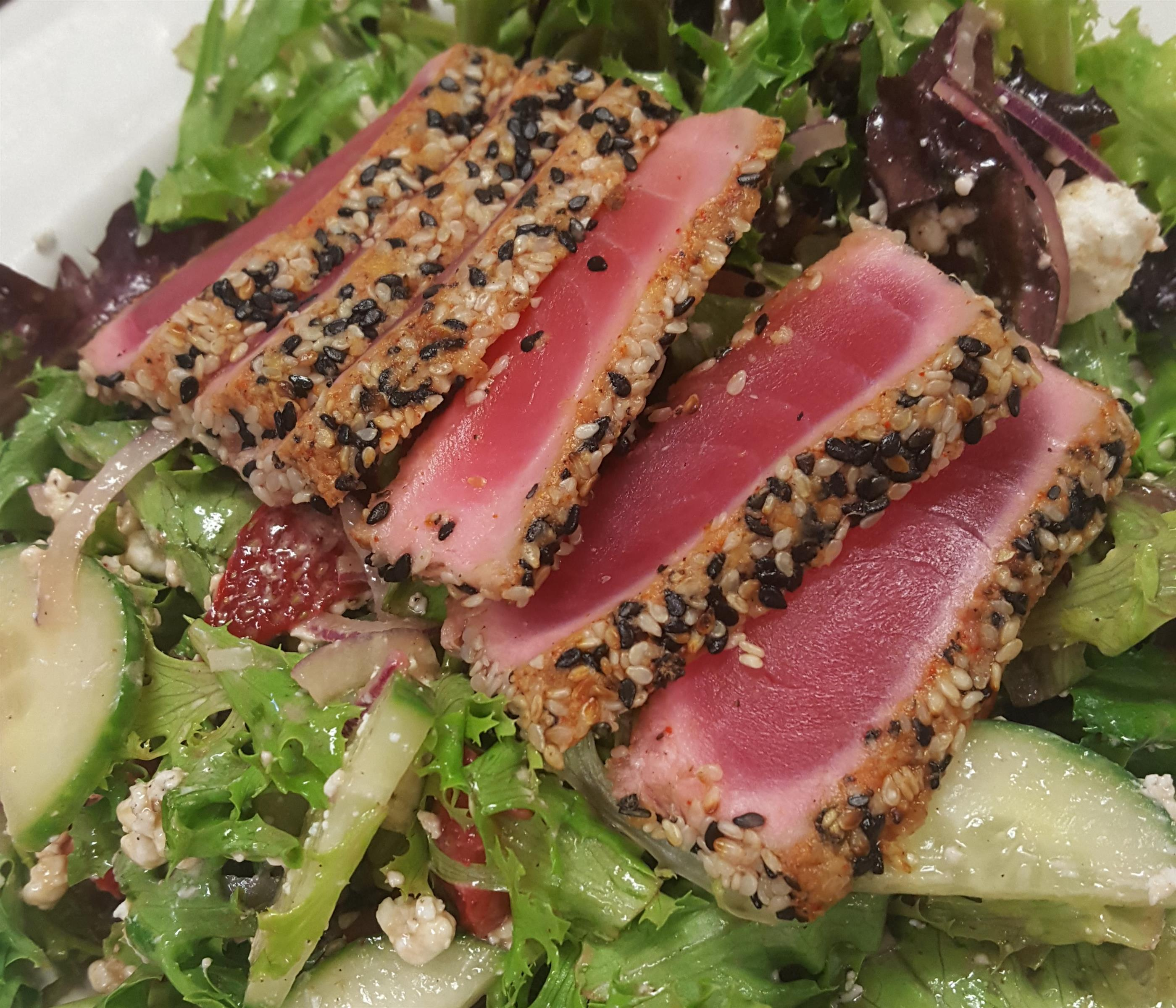 Salad with sesame crusted ahi tuna.