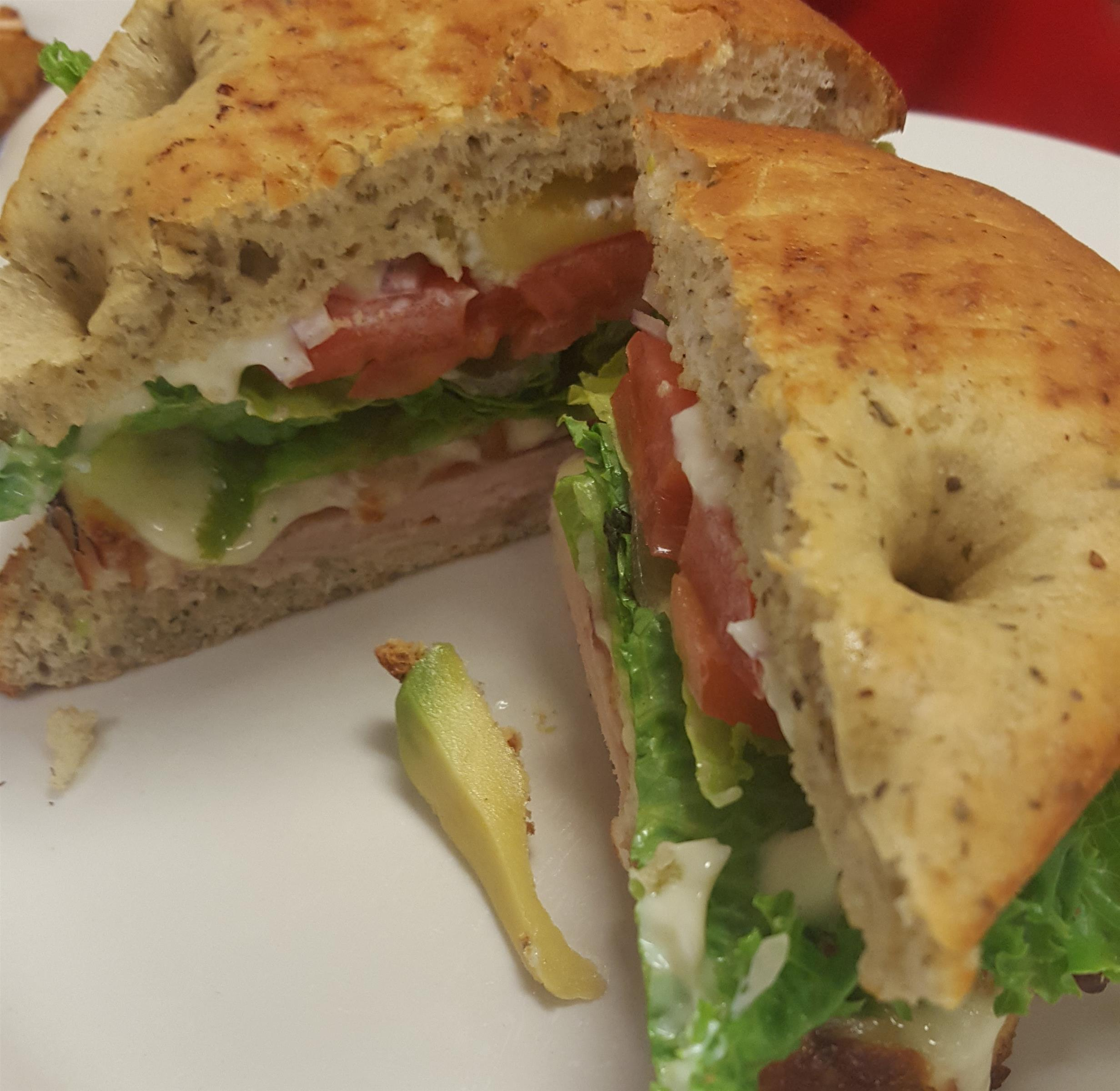 Bagel sandwich with tomato, lettuce, cheese
