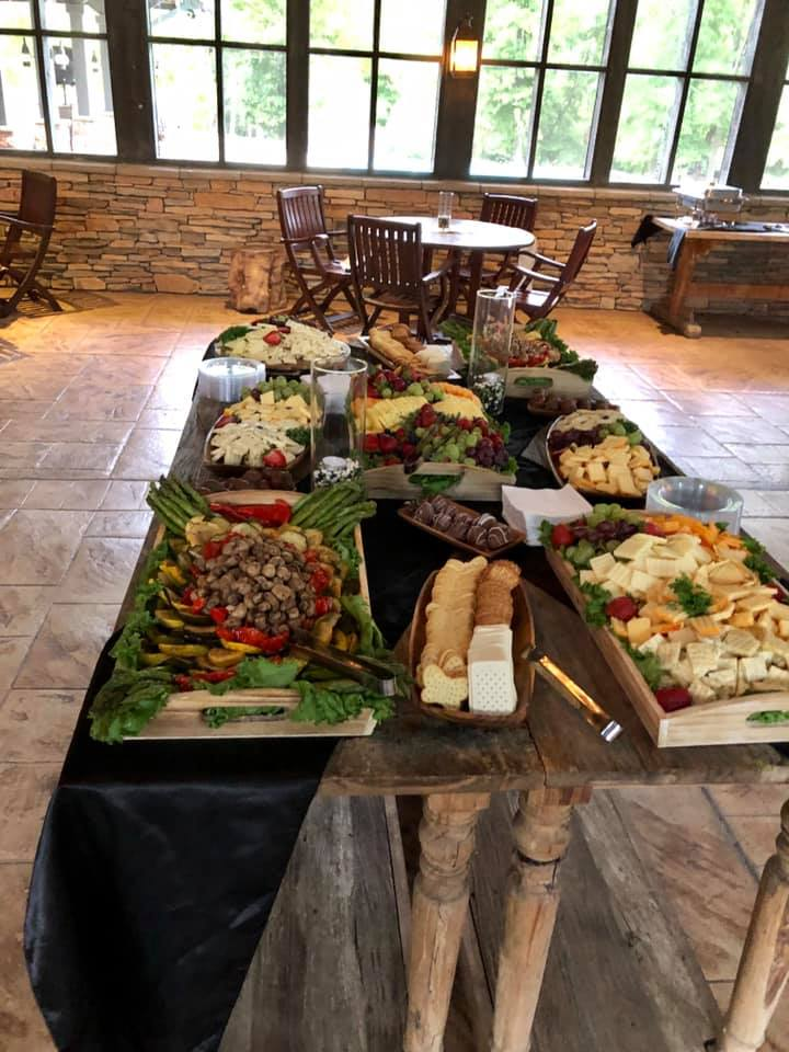 large spread of fruits, cheeses and crackers