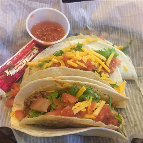 three soft shell tacos wih sauce