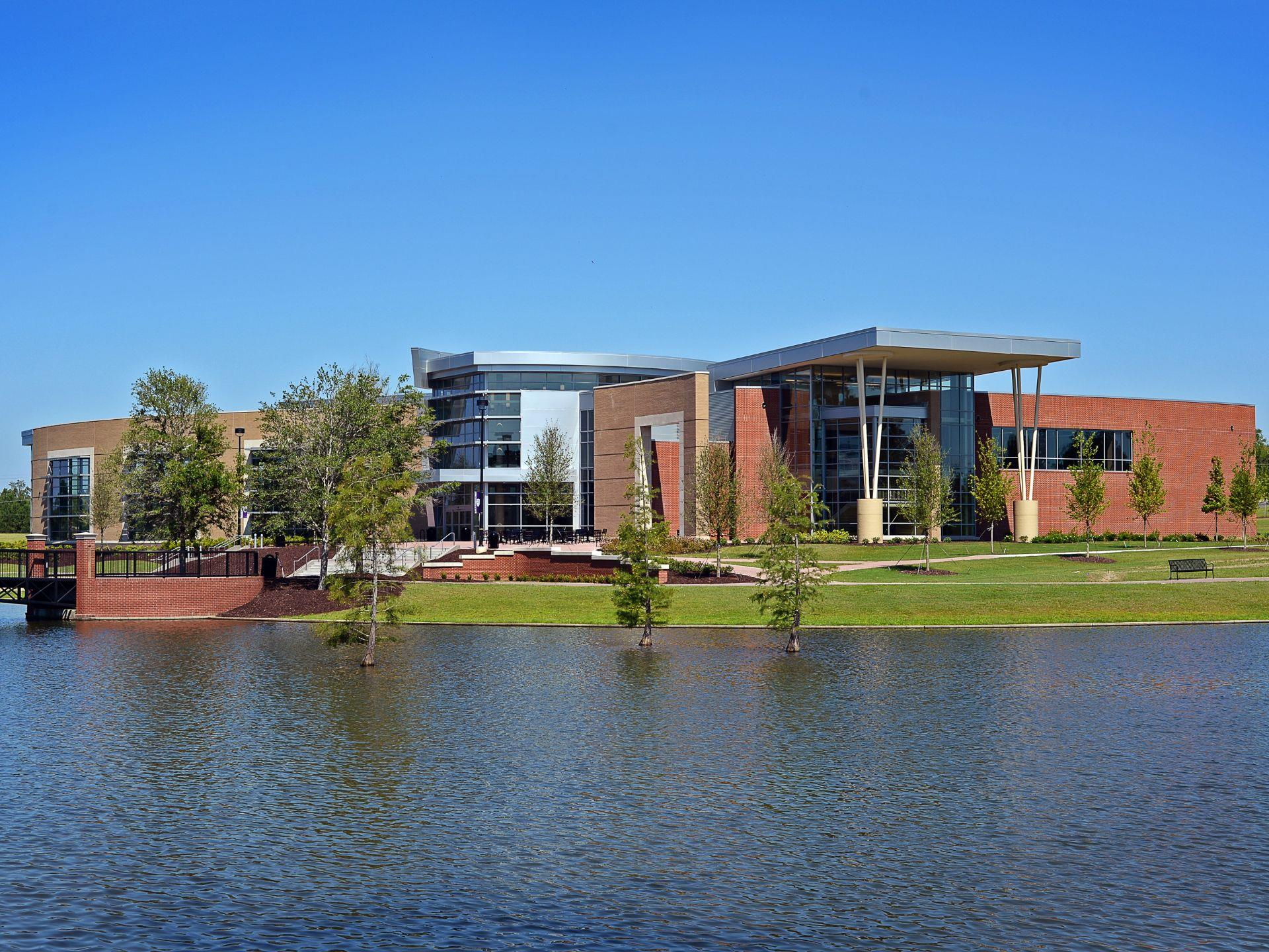 Exterior shot of Middle Georgia State University Recreation & Wellness Center with lake in front
