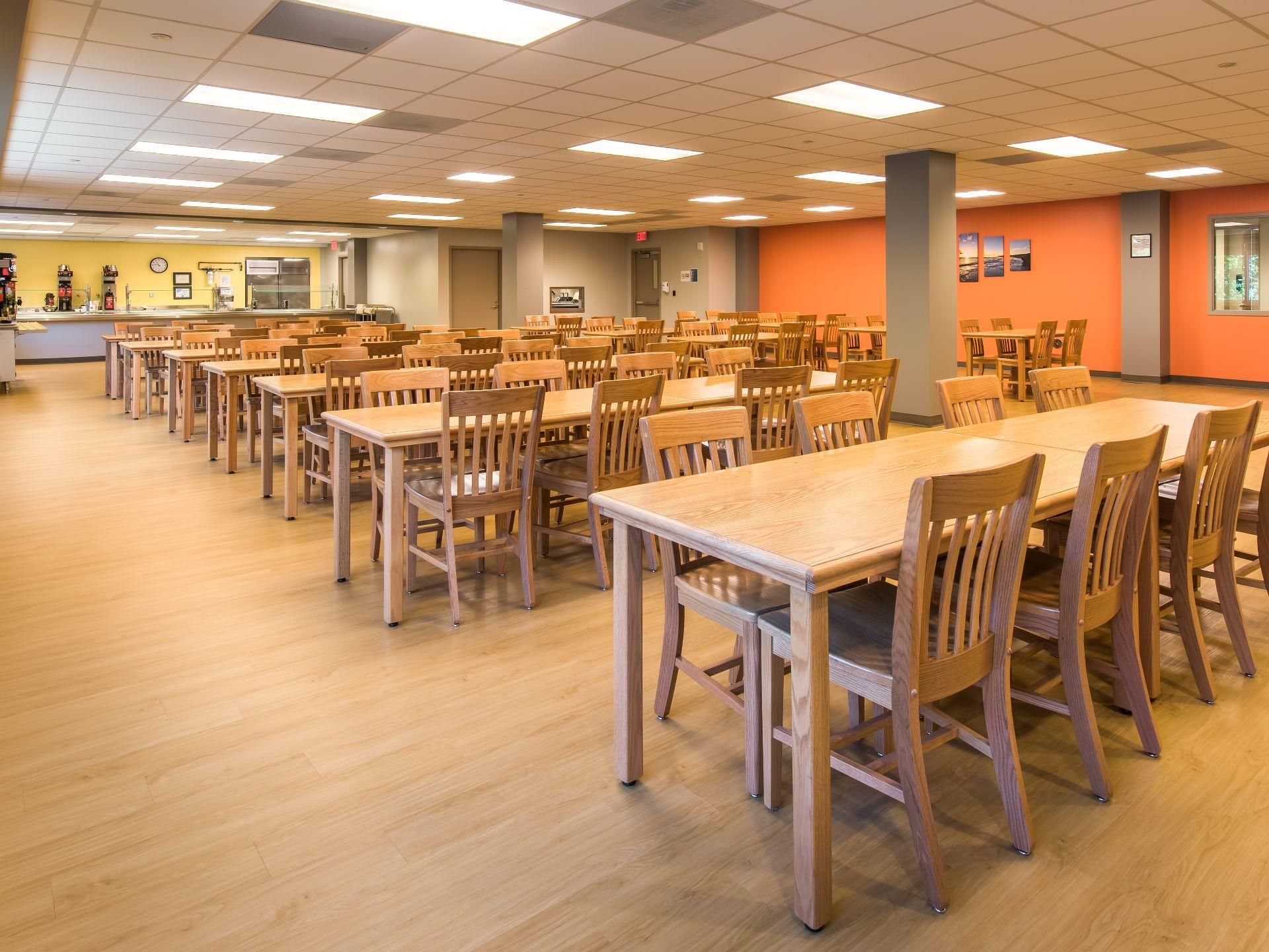 Cafeteria with wooden tables and chairs