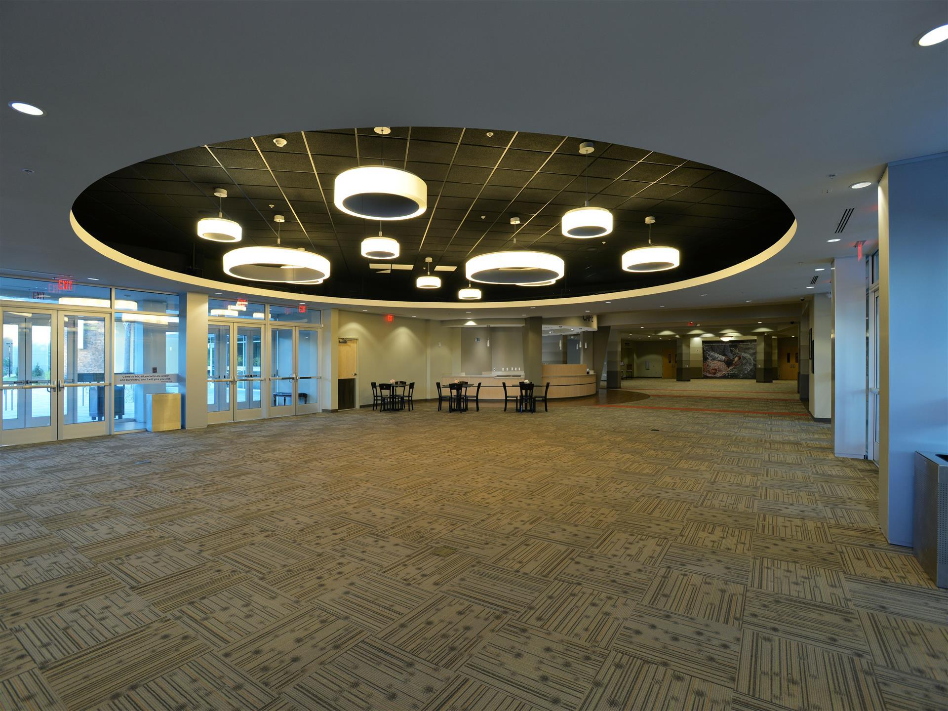 Open indoor lobby entrance with decorative lights in ceiling.