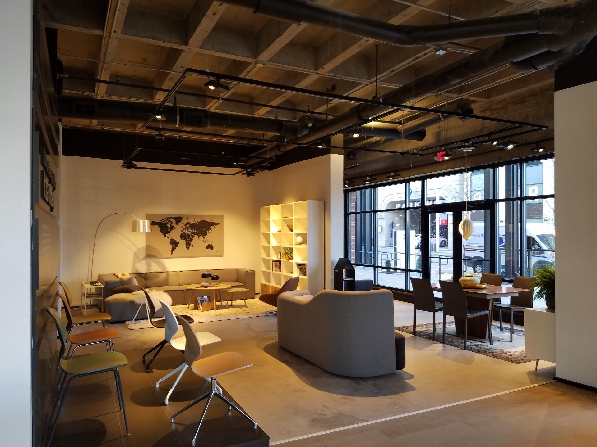 view of interior with exposed ceiling beams and wooden accents with modern map art on wall and modern furniture and decorations