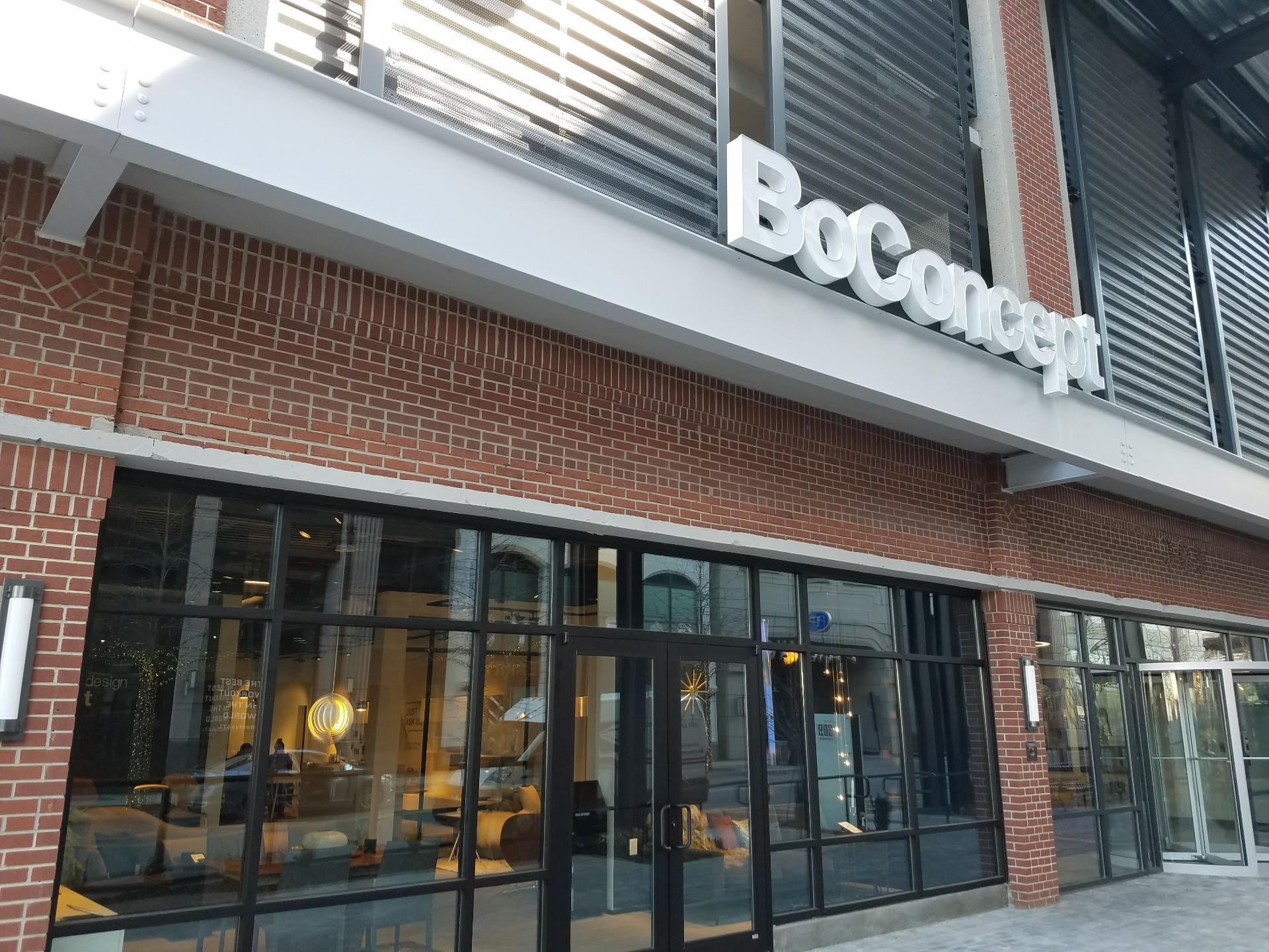 exterior of store with brick and white modern BoContept sign above entrance