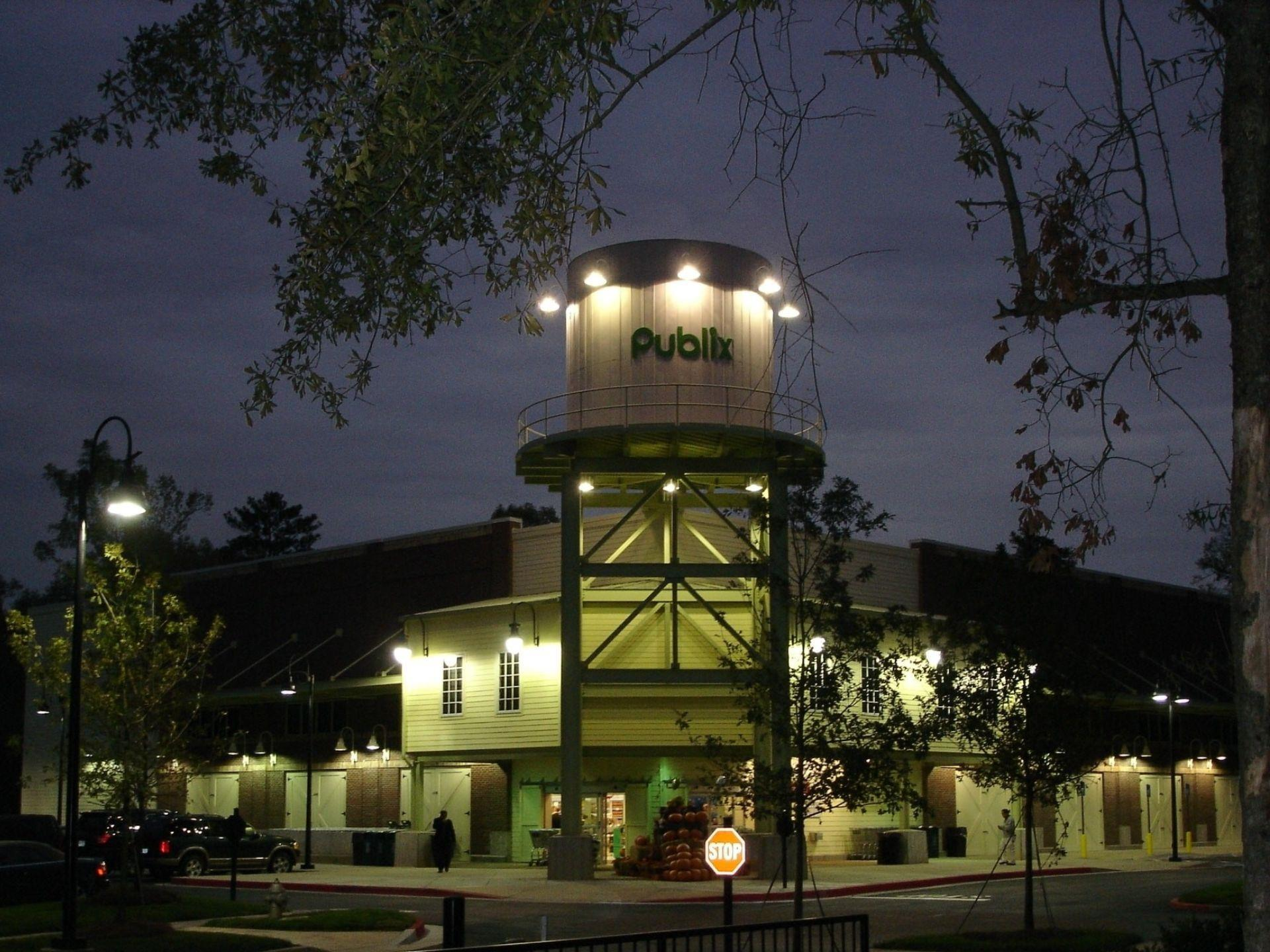 view of publix tower lit up in the evening