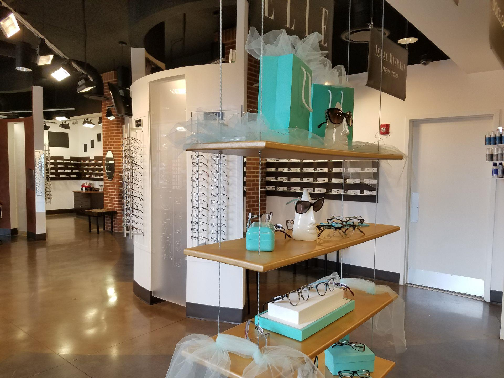 inside of store with sunglasses and blue boxes on display