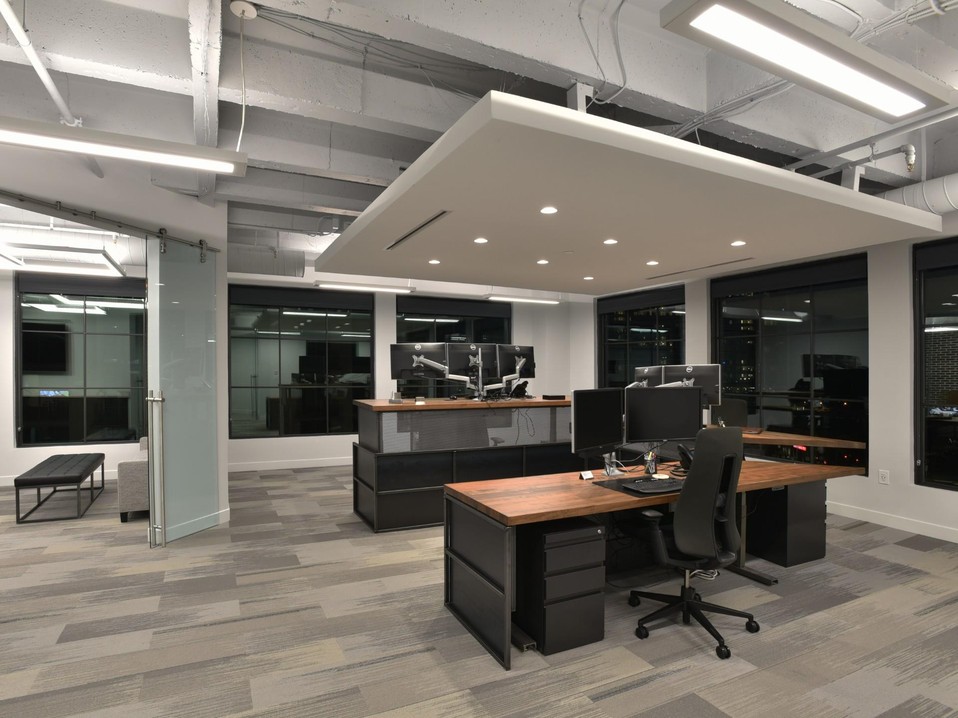 Work space with open ceiling, night photo surrounded by windows