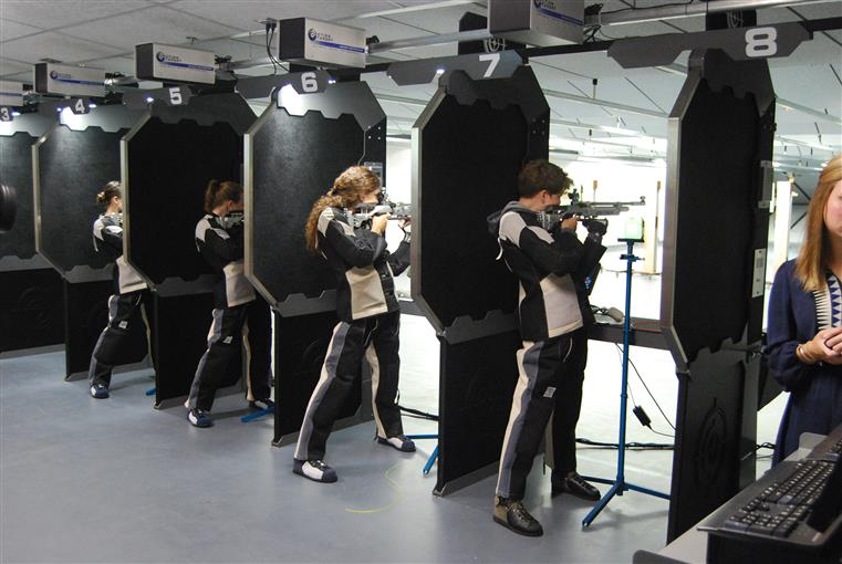 Fire range with students in rows with gun in hand