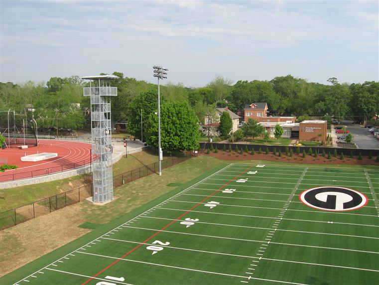 Football field with filming/observation tower on the left-hand side of the photo