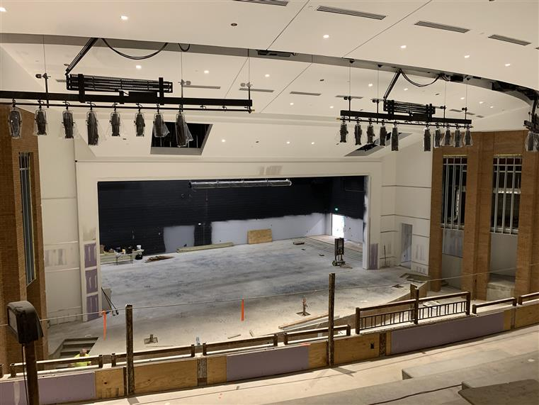 Interior of a perforing arts center under constuction. View from raised seating/balcony