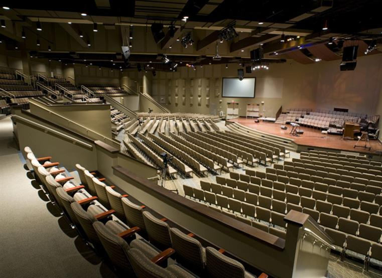 Worship center with stadium seating and screens