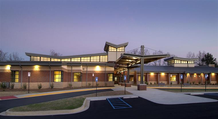 Community Center - recreation - exterior photo of twilight photo of building, canopy entry, sidewalk and walkway