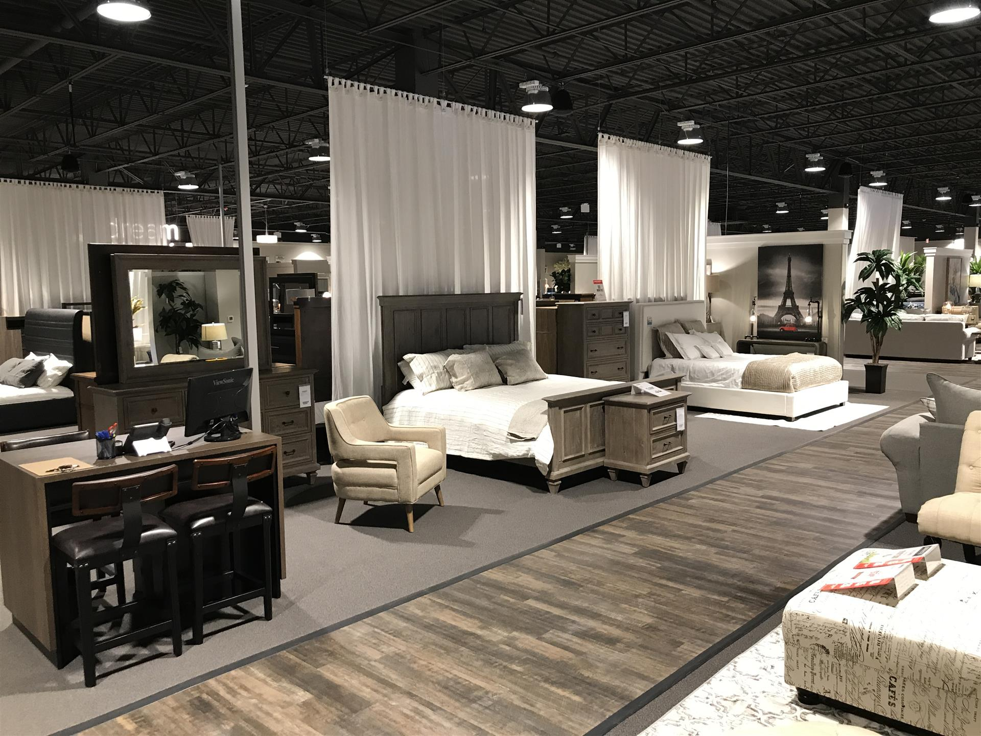 furniture showroom, shows beds, nightstands with various room set ups