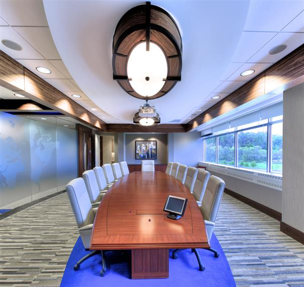 conference room with long table and lots of windows - modern look
