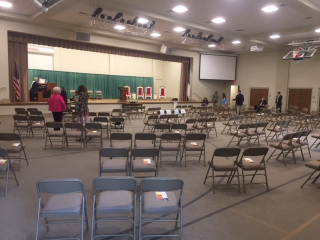 auditorium - stage and folding chairs on the floor.