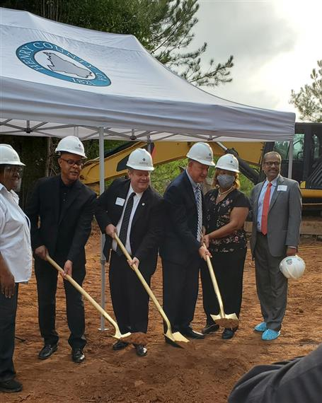6 indidiviuals  with shovels for a groundbreaking ceremony