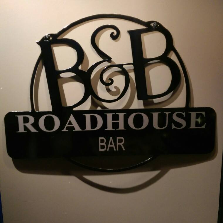 B and B roadhouse bar sign on interior wall.