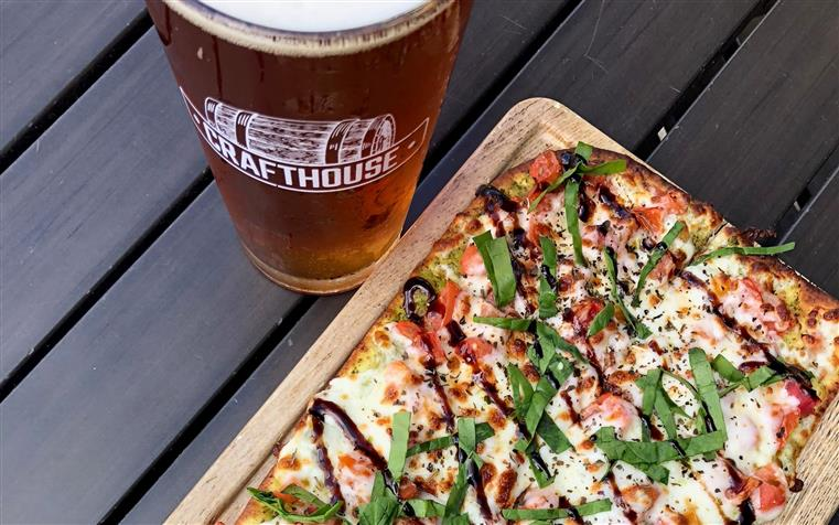 flatbread pizza with a glass of beer