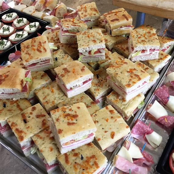 sandwiches cut in squares on a tray