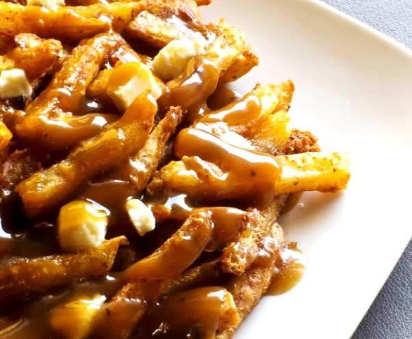 poutine: A full pound of crispy fresh-cut French Fries topped with squeaky-fresh cheddar cheese curds and finished with our delicious brisket gravy