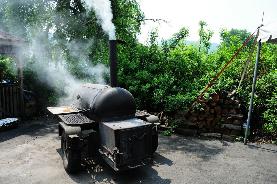 smoke coming out of outdoor grill
