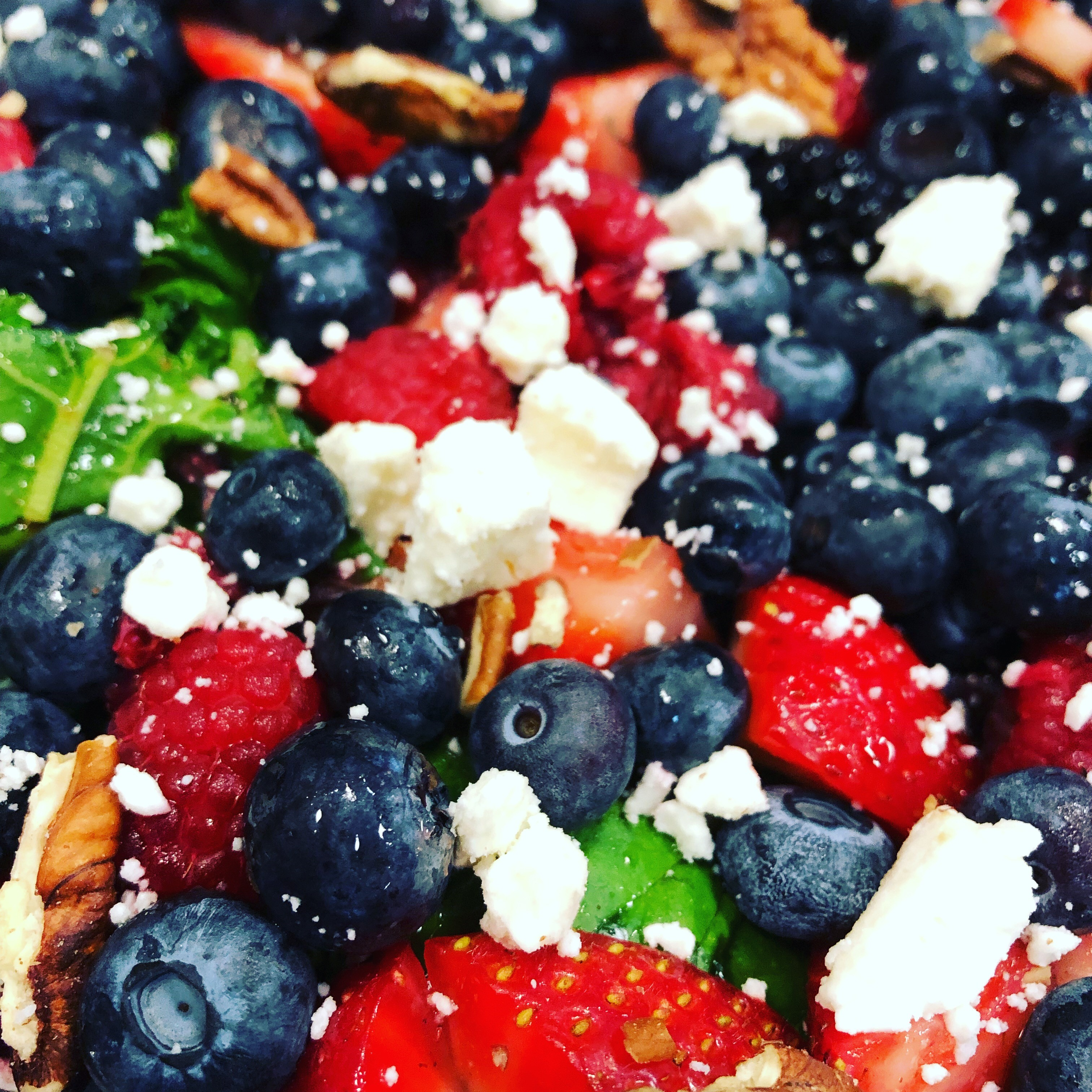 Salad with blueberries, strawberries, and Feta cheese.