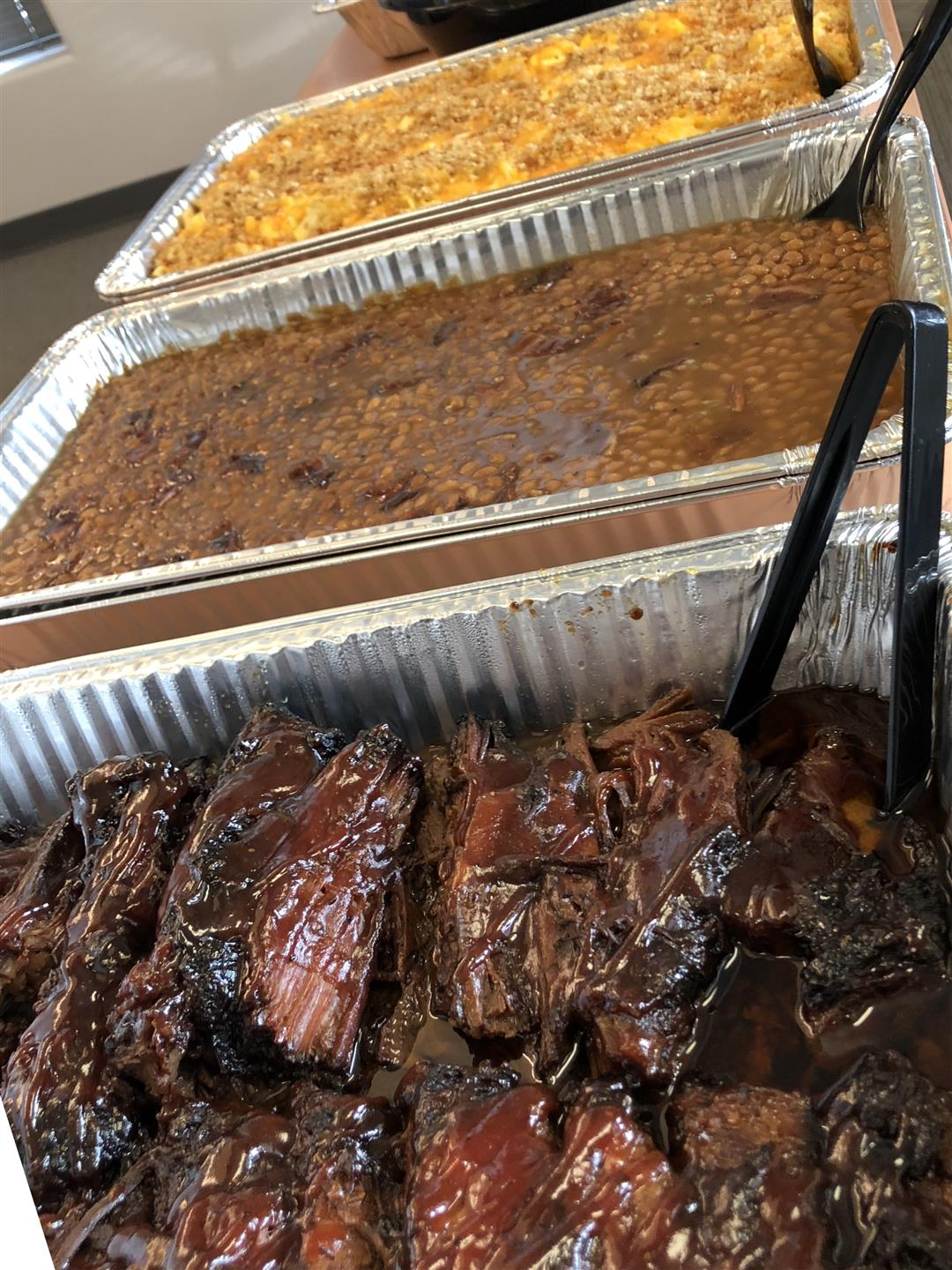 bbq brisket and beans on buffet line