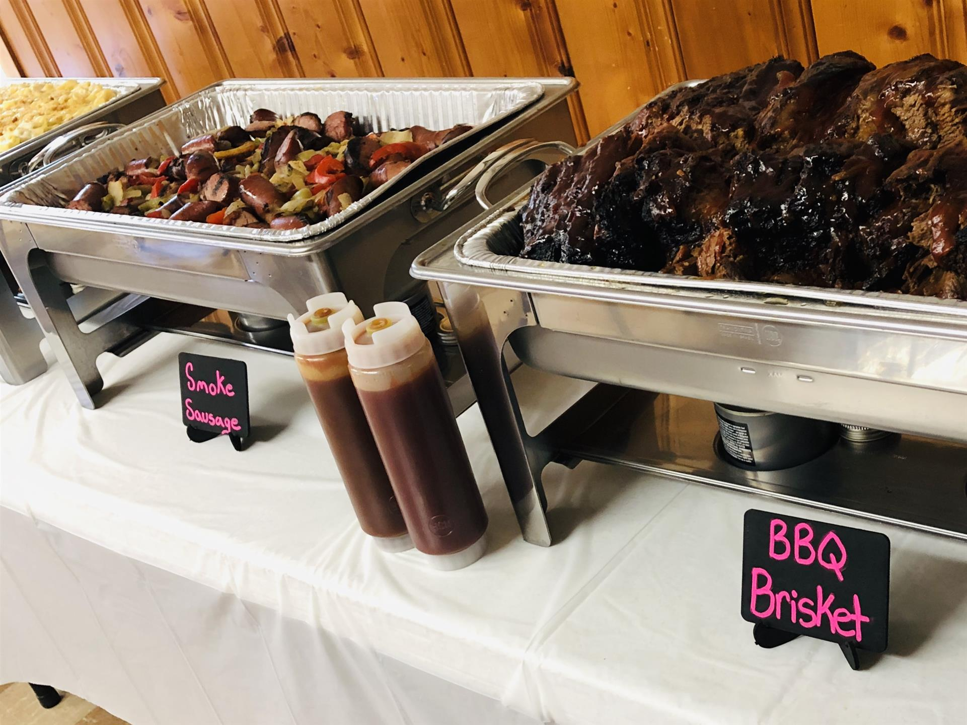bbq brisket and smoked sausage on buffet