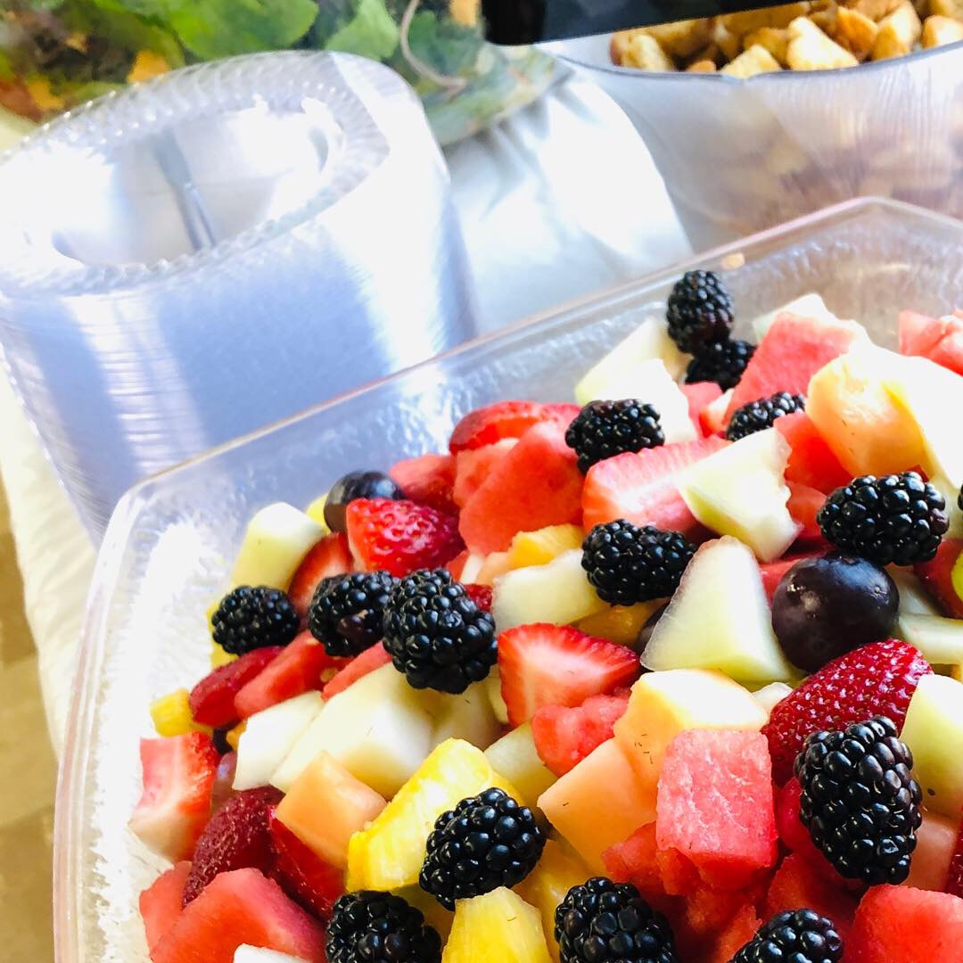 fresh fruit bowl with watermelon, blackberries, honeydew and cantaloupe