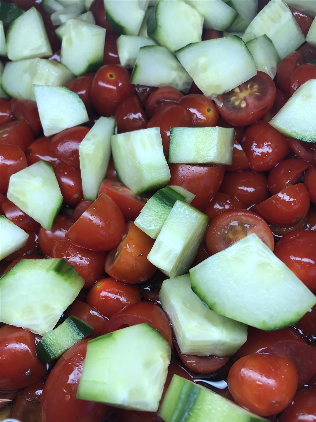 fresh chopped cherry tomatoes and cucumbers