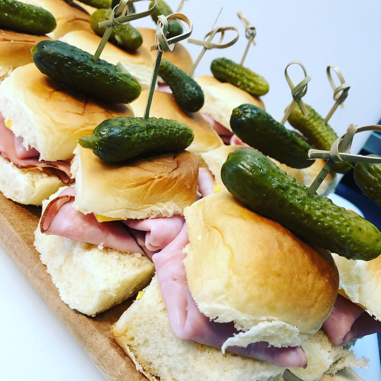 ham and cheese sliders topped with gerkin pickles