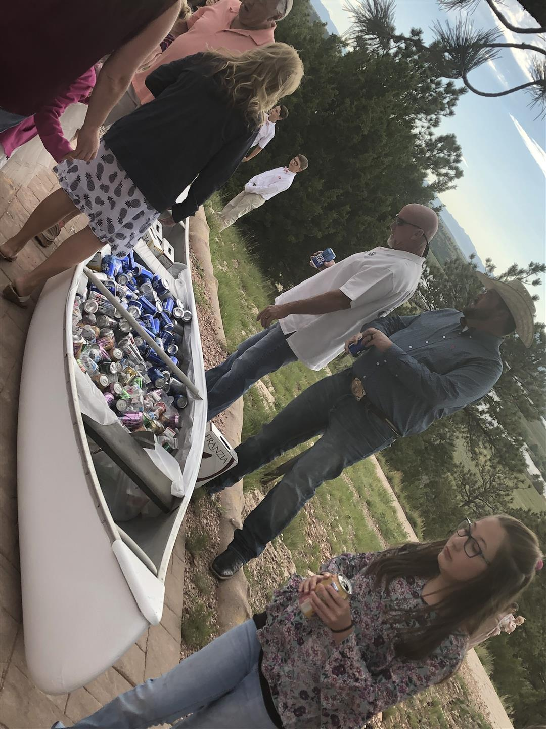 lake side wedding - white canoe filled with canned and bottled beverages for serving