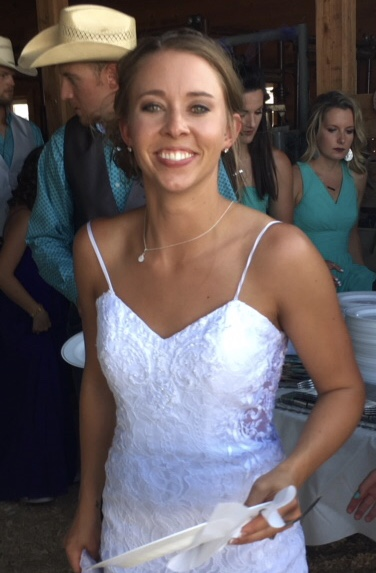 beautiful new bride smiling at wedding reception