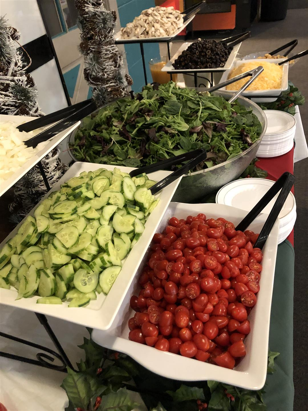salad bar with mixed greens and assorted topping options