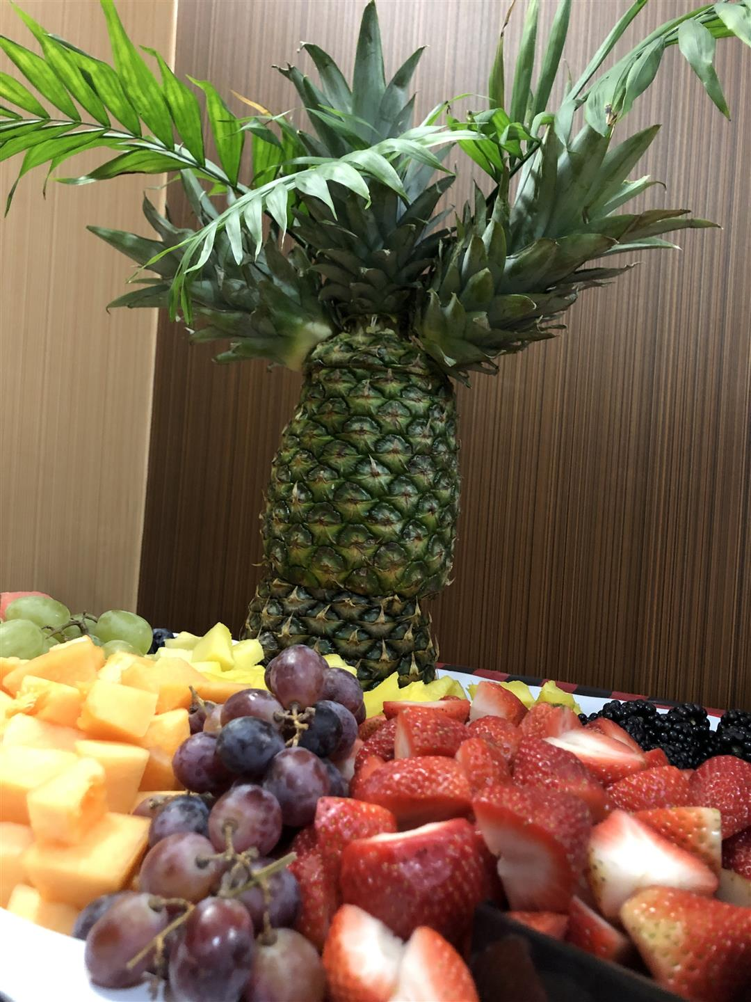 cut fruit platter with pineapple tree