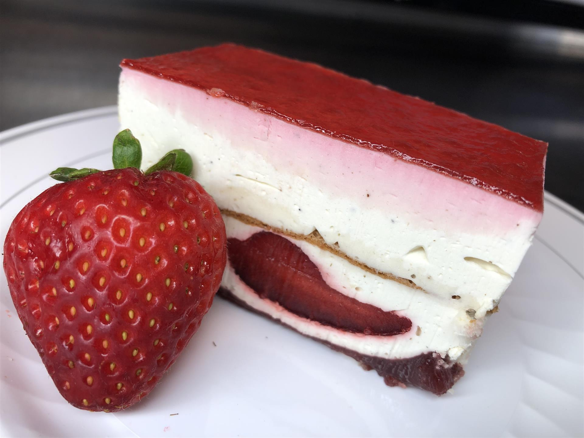 slice of strawberry strip cake with fresh strawberry