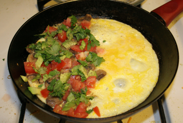 vegetable omelette in a skillet being cooked