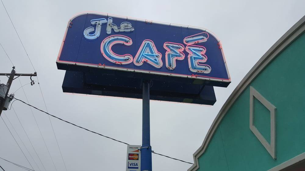 large exterior signage for the cafe displaying their logo