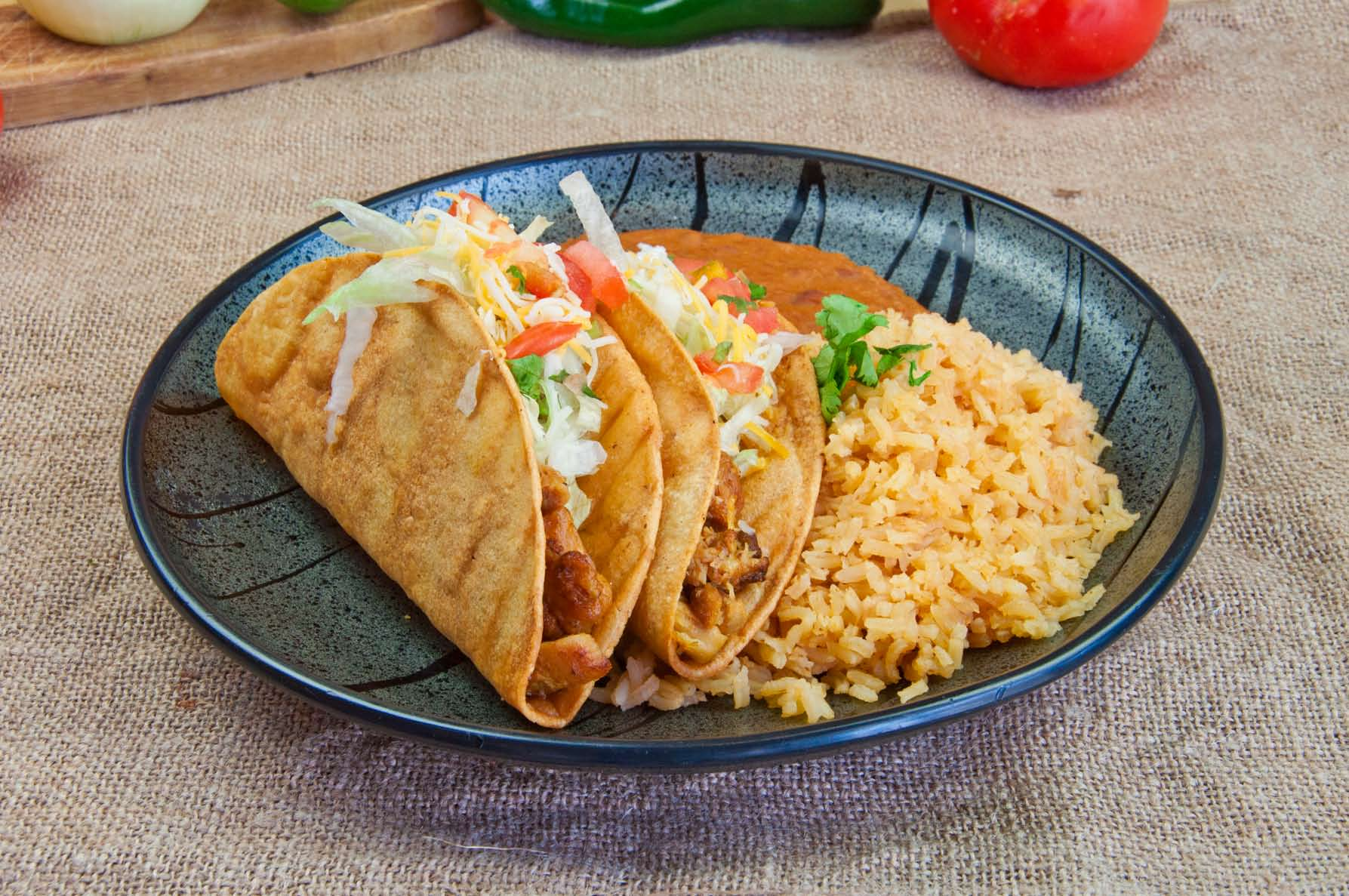 Two Hardshell Tacos with Side of Yellow Rice