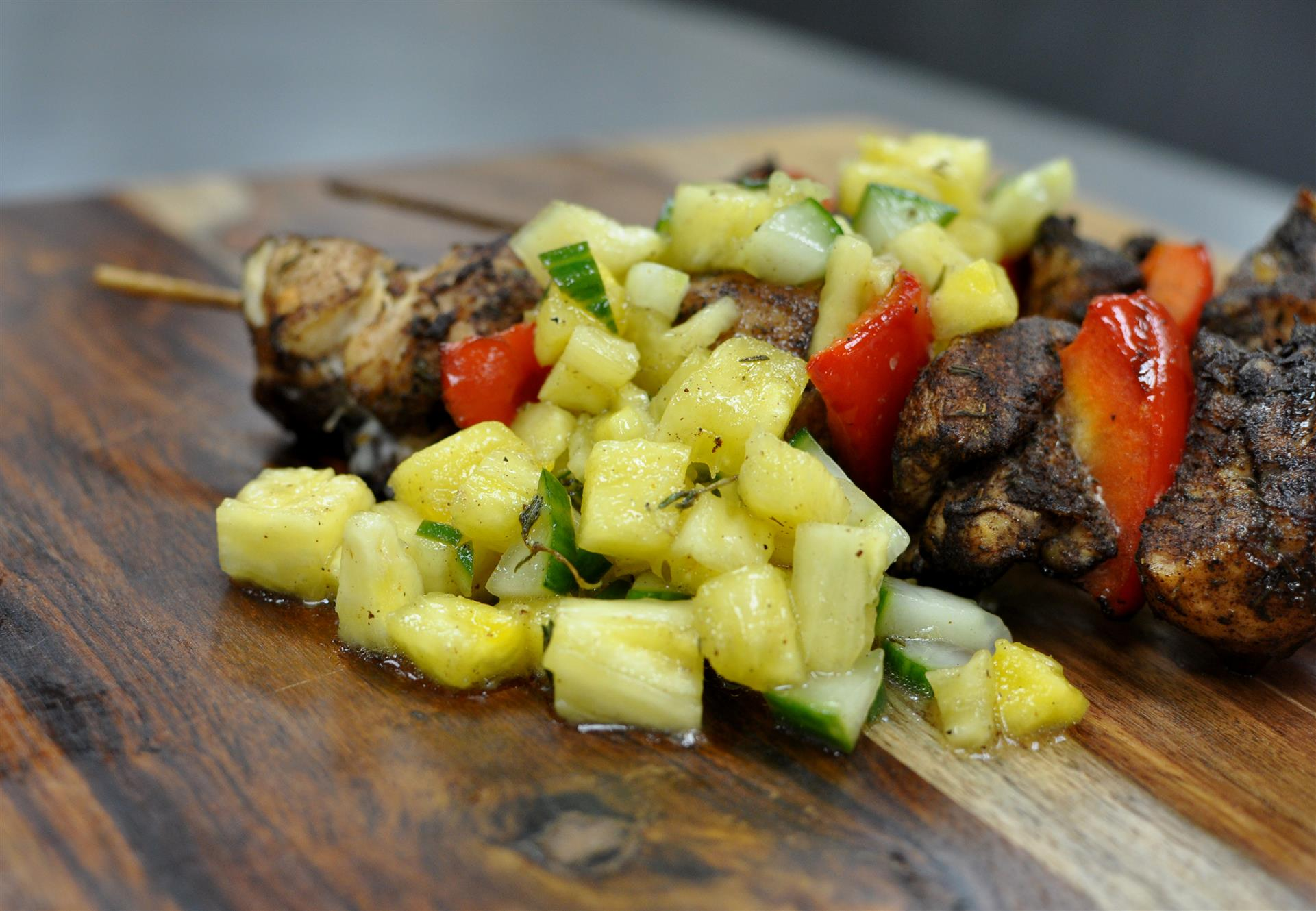 Steak kabob topped with sliced pineapple salad